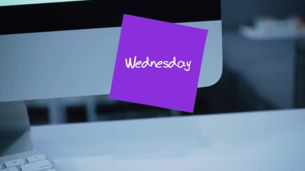 Wednesday. Days of the week. The inscription on the sticker on the monitor. Message. Motivation. Reminder. Handwritten text written with a marker. Color sticker. A message for an employee, a colleague