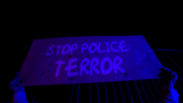 Black Lives Matter. The crowd protests against racial inequality. Riot against police brutality and racism. Red and blue Light police car. Black Rights Protest after George Floyds Death