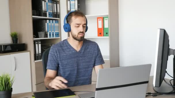 Man working as graphic designer in his office