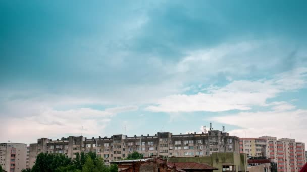 Fast moving storm clouds over buildings in residential area