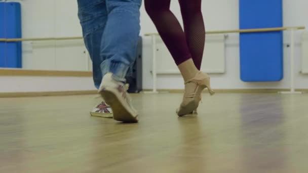 Feet of man and woman dancing