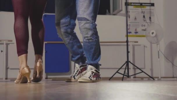 Close up feet of professional dancers in big studio hall
