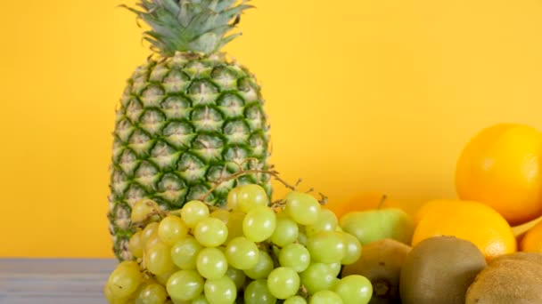 Healthy and organic exotic fruits on yellow background