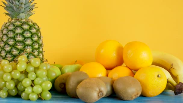 Variety mix of exotic fruits on yellow background