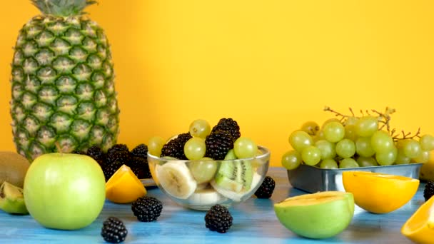 Delicious homemade fruit salad in glass bowl