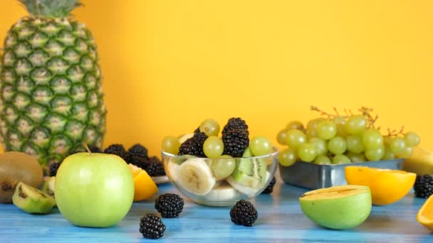 Healthy and delicious mix of exotic fruits in glass bowl