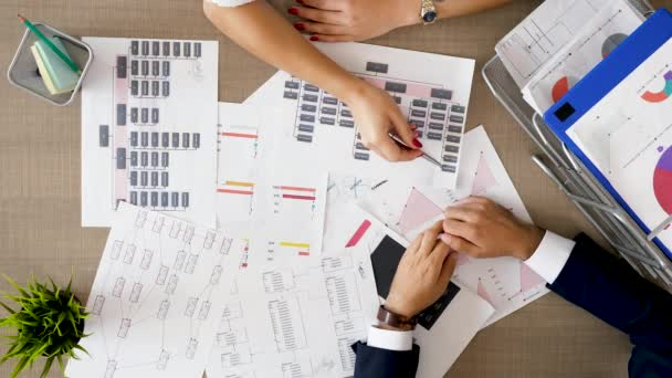 Corporate financial team analyzing charts and diagrams with market sales