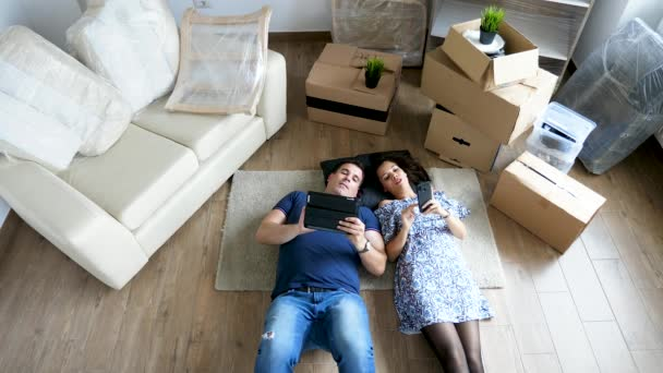 Couple relaxing on the floor of their new home