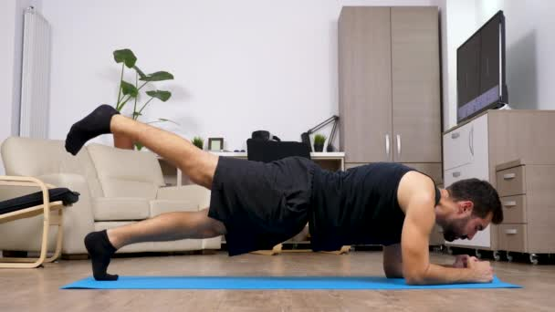 Man doing different exercises on a blue mat