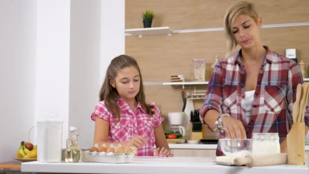 Mother and daughter at the kitchen
