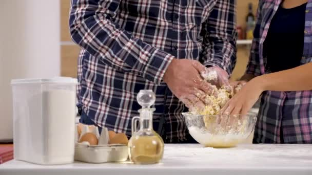Close up of couple hands preparing dough for baking