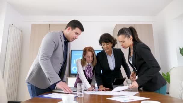 Business people in company meeting room brainstorming