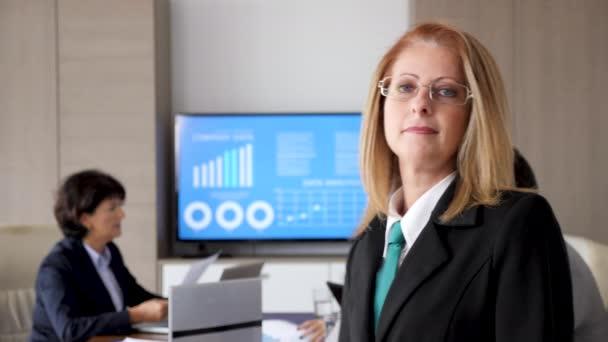Close up slow motion portrait of smiling businesswoman