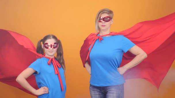 Mother and daughter playing superheroes