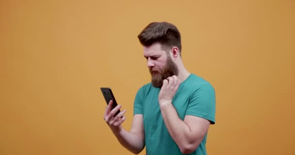 Man looks at his smartphone and receives great news