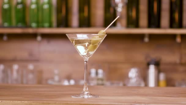 Glass of alcoholic beverage on a bar counter