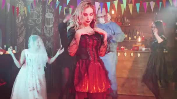 Young woman in a vampire enchantress halloween costume trying to seduce
