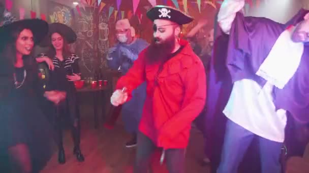 Evil pirate dancing in the middle of a group of friends celebrating halloween