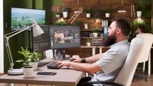 Male editor working in post production studio