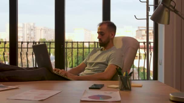 Manager of start up company working relaxed in sunset light