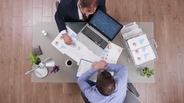Businessmen working together at office desk
