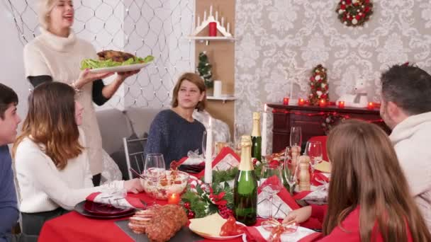 Woman arriving with delicious turkey on christmas family dinner