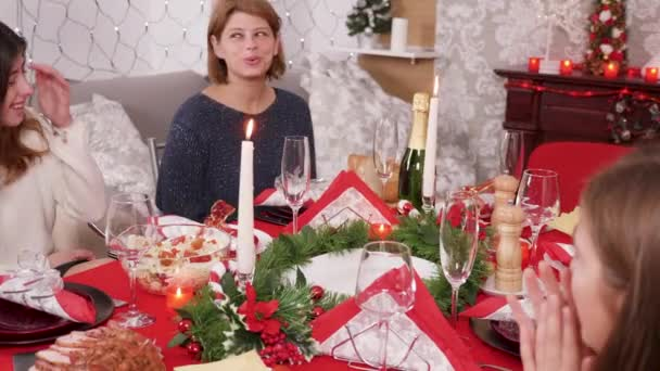 Adult woman arriving with traditional turkey on christmas dinner