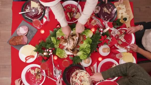 Timelapse Top view of family celebrating christmas with a feast