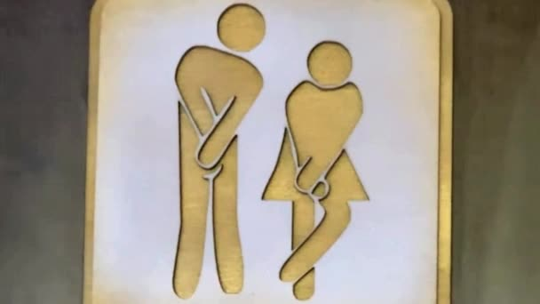 Man and woman toilet sign in public space. Female and male symbols for comfort room. Public toilet sign. CR symbol for two genders. Water closet or bathroom.Designator for WC