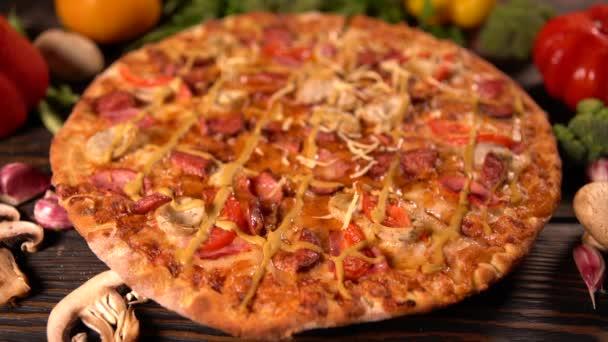 Spinning whole tasty Mediterranean pizza