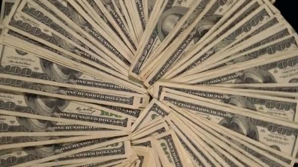 Spinning background of fanned 100 USD bills