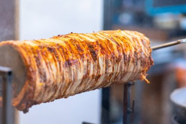 Delicious spicy doner kebab grilling on rotisserie