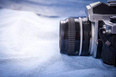 camera on blue blackground , Still Life