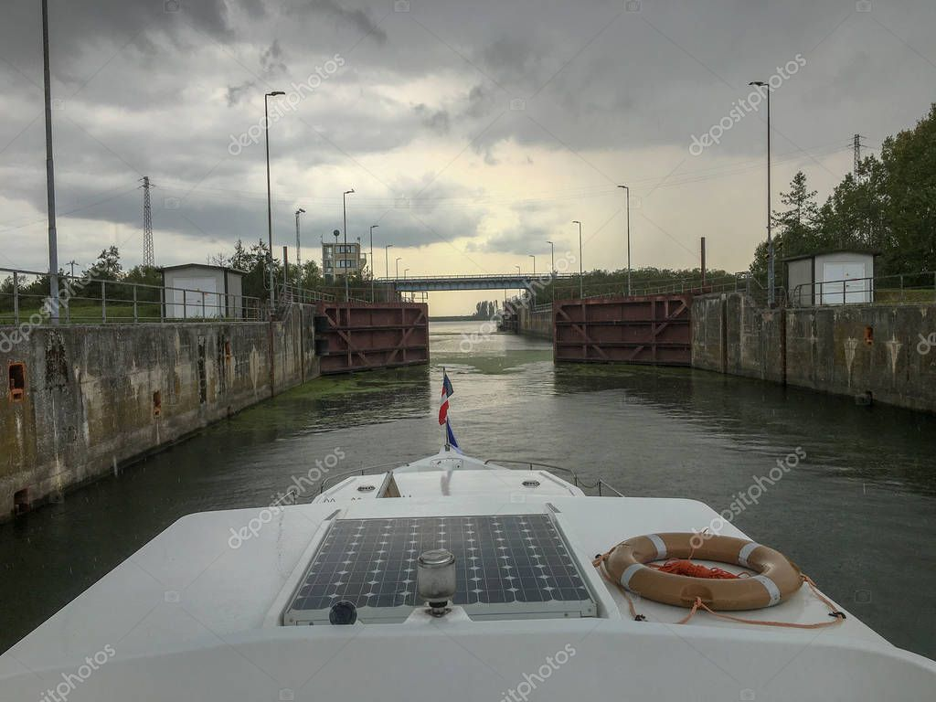 passing the ship sluice in a venice canal