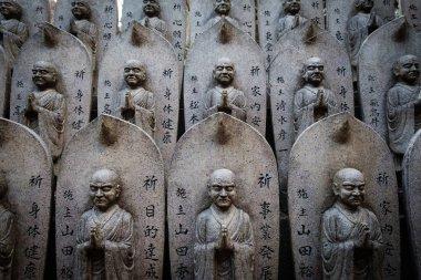 MIYAJIMA, JAPAN - FEB 03, 2018: Pattern of Stone Buddha sculptures in shrine of Miyajima