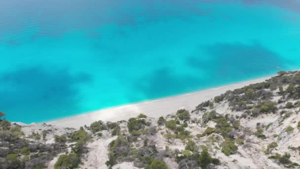 Famous Egremni beach, aerial view of a rocky cliffs and waves crashing at the sandy beach, Lefkada Greece
