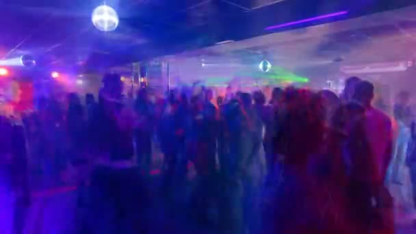 Young people are dancing in a nightclub, timelapse