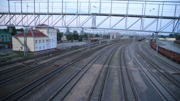 Passenger train rides the station, top view, time-laps