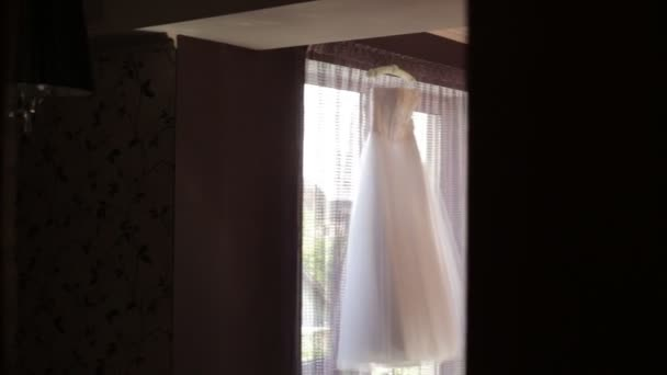 Beautiful wedding dress hanging in the room
