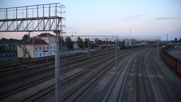 Passenger train rides the station, top view