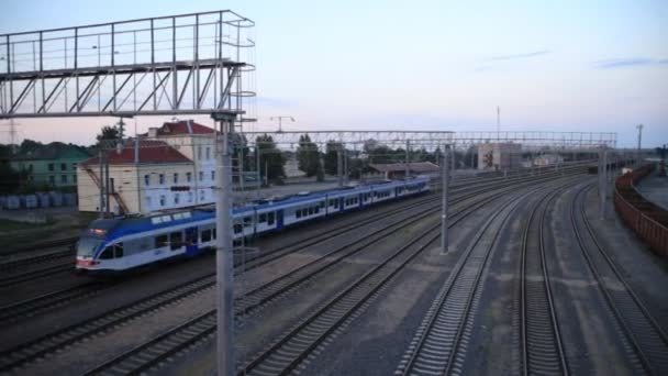 Modern passenger electric train, passing station