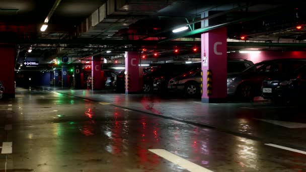Underground car parking in a large shopping center, people