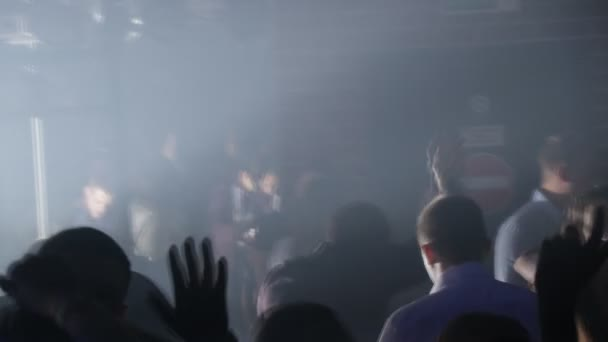 Night club, light music and dancing, hands and emotions of people, disco