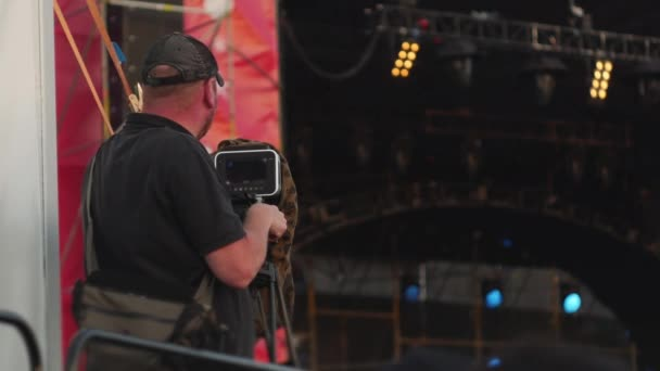 cameraman shoots a stage during music concert