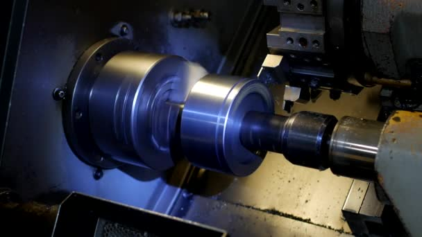 CNC lathe pulls out part of metal workpiece pulley, modern lathe for metal processing, close-up, manufacture