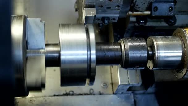 CNC lathe pulls out part of metal workpiece pulley, modern lathe for metal processing, close-up, metalworking