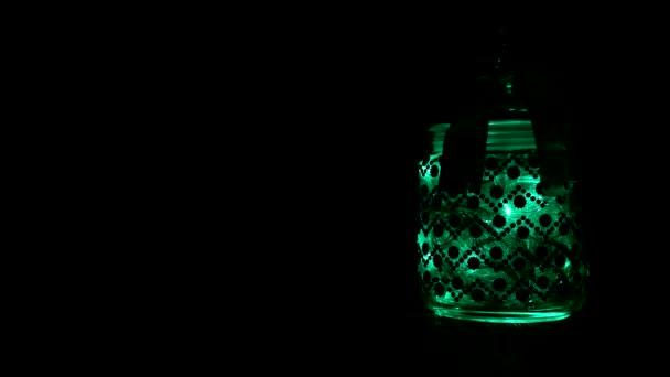 Üveg edény Szilveszter csillogó multi-színes fények, az új évben, 2019, karácsony, másol hely, dekoráció, design