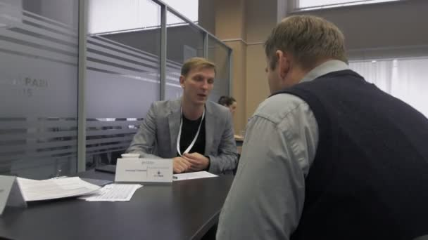 male recruiter communicates with the job seeker during hiring in Hi-Tech Park MINSK, BELARUS 11.24.18