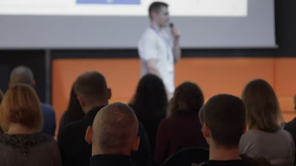 male CEO or speaker tells something during business event or conference