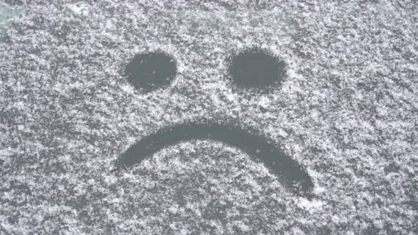 sad smile from the snow on the car window, slow motion, the onset of winter